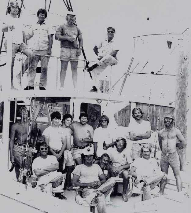 """An old photo from the Early Bird. On the bridge, Capt. Jim Loebsach, Capt. Chip Shafer and Capt.Emory Dillon (right). In the cockpit are mates Mike Everley, Billy Dillon, Bull Tolson, John Coleman, Ross """"Flash"""" Clark, Pete Sheehan, Phillip Fender, Randy Turner, Ches Jenkins and Dorsett Ward."""