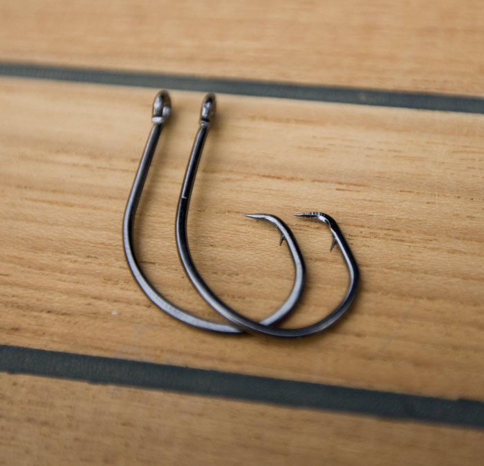 "The difference is hard to see from the photograph but the hook on the right has the new ""Forged Tip."" The hook on the left is the old style needle point."