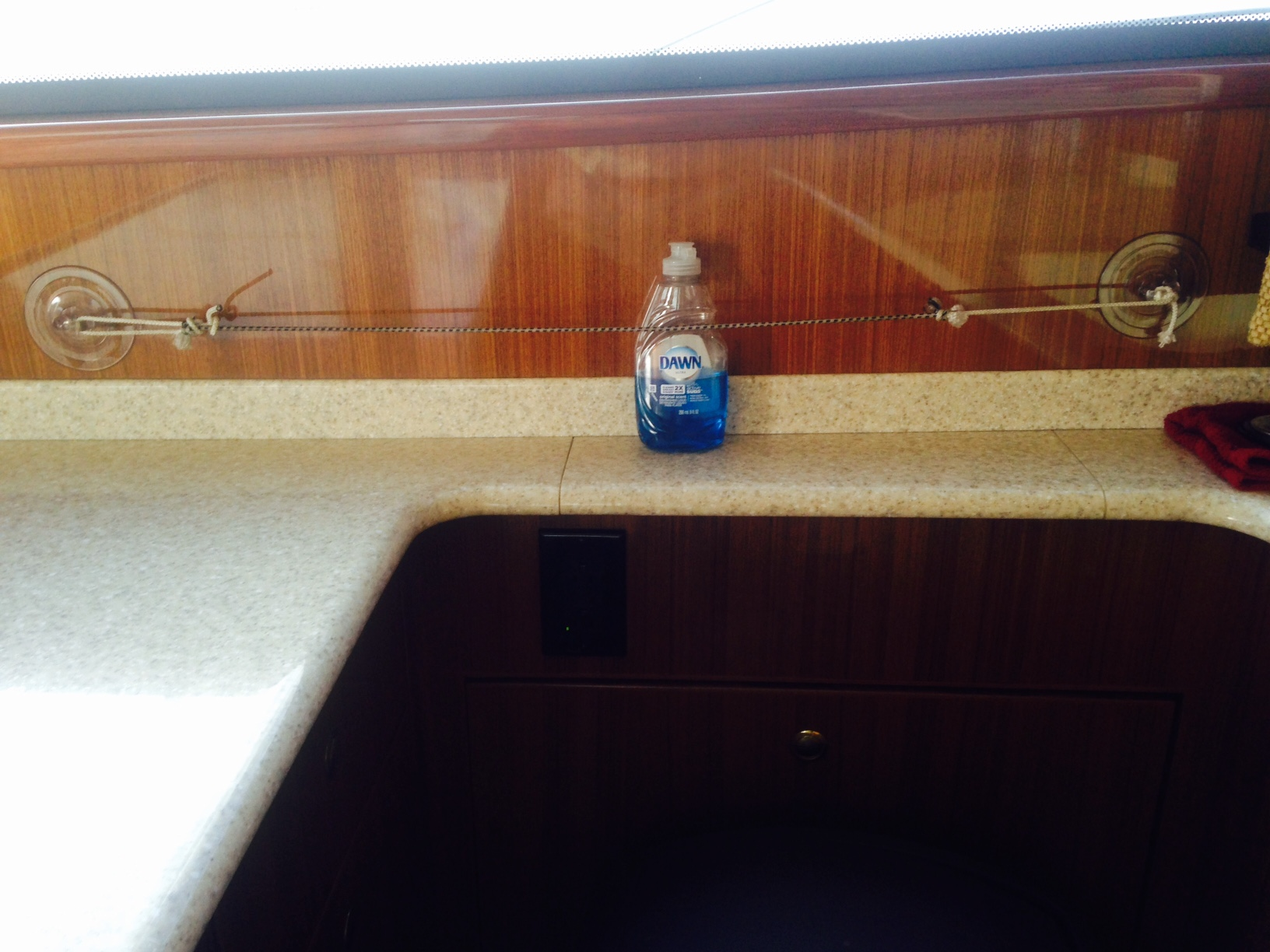 suction cup holding dishwashing detergent in a boats galley