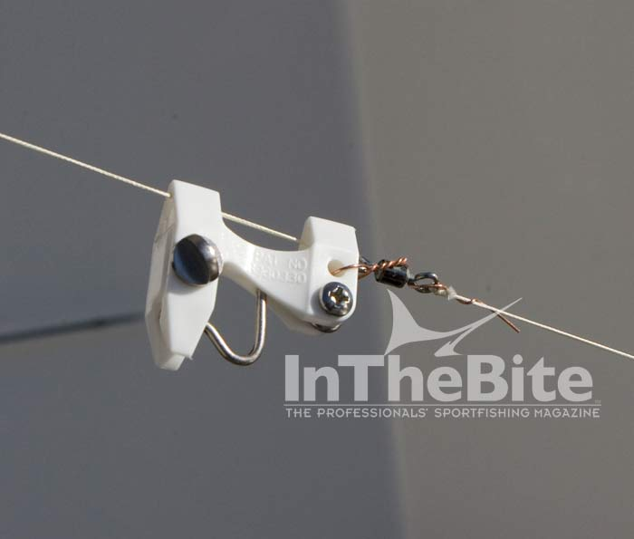 Finally, when deploying your kite wrap the copper wire around the swivel after clipping your mainline in. When retrieving your kite line the wire will release as the clip hits your kite rod tip.