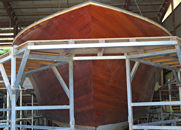 The bright hulled travel yacht is finished without mechanical fasteners.