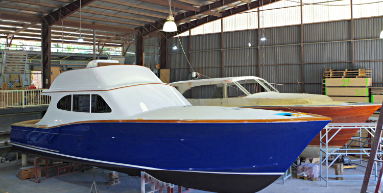 The Maverick 50 and a bright hulled travel yacht