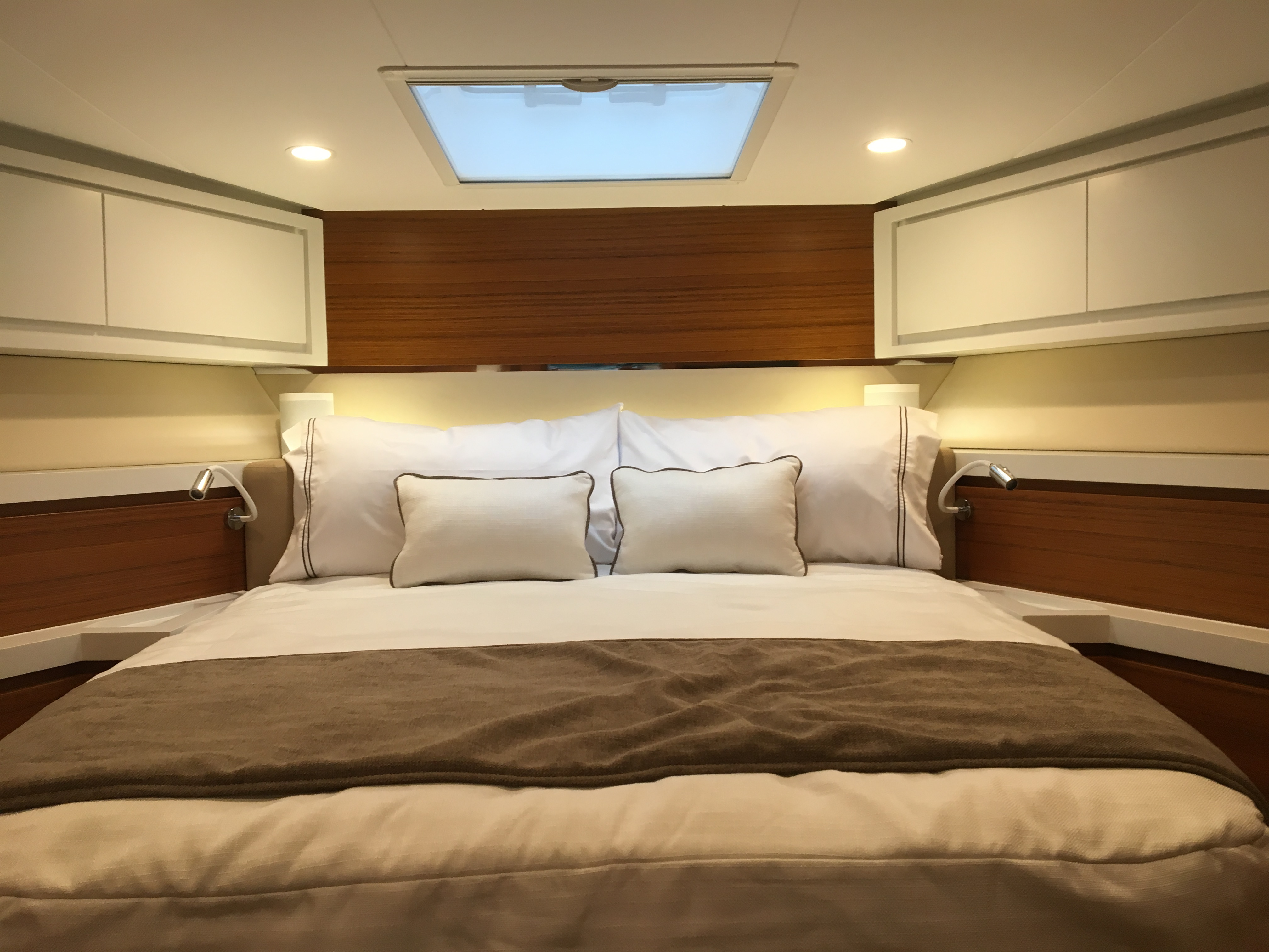 Bertram 61 forward stateroom showing the bed