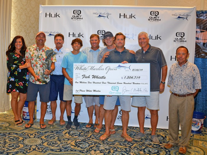 Fish Whistle team with winning check for 1.3 million