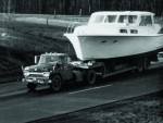 Shows the first Hatteras boat Knit Wits being transported on a trailer