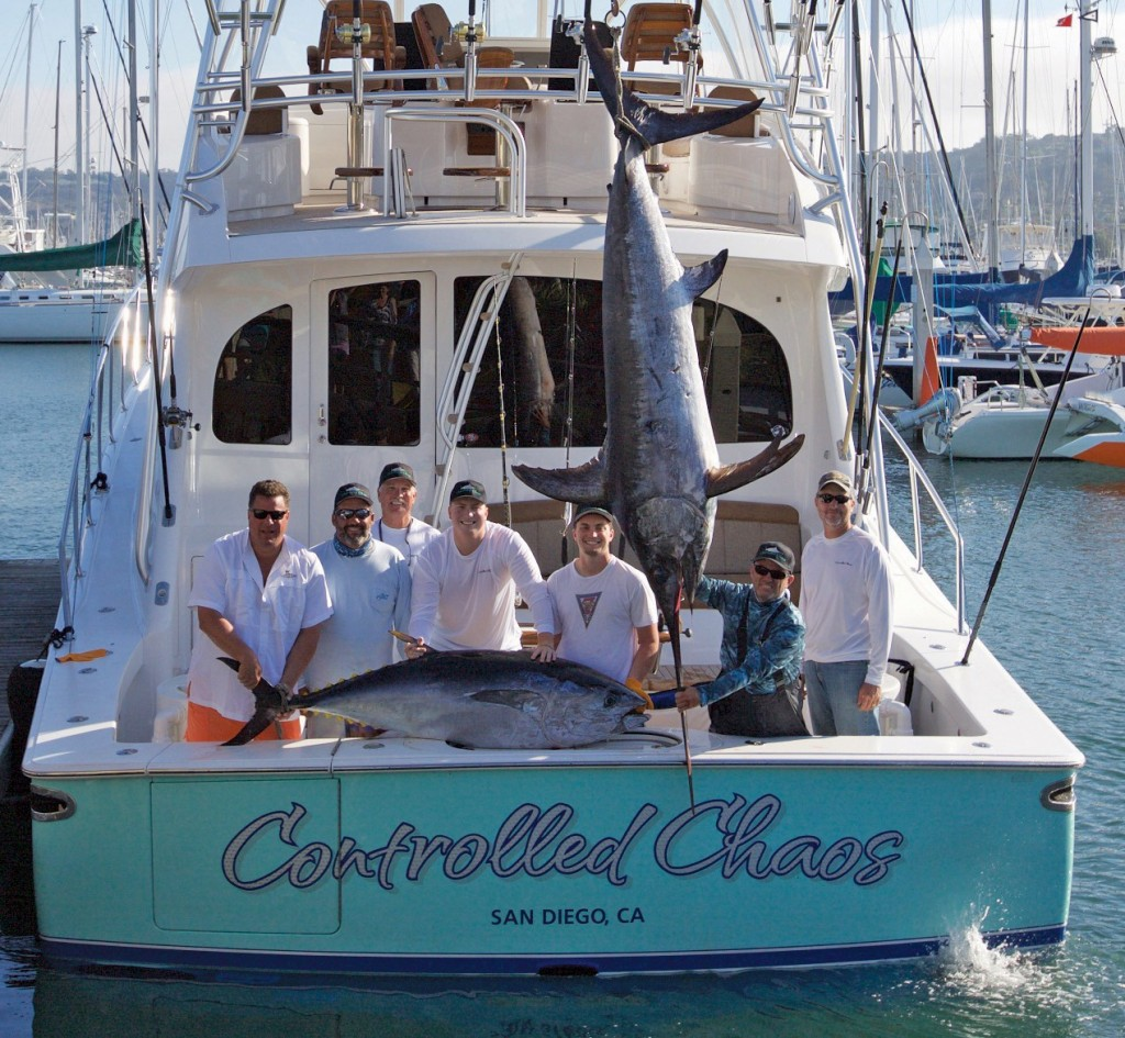 crew with marlin on boat