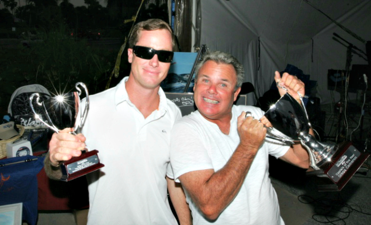 captain glenn cameron and his mate posing for a picture with the captain of the year trophy