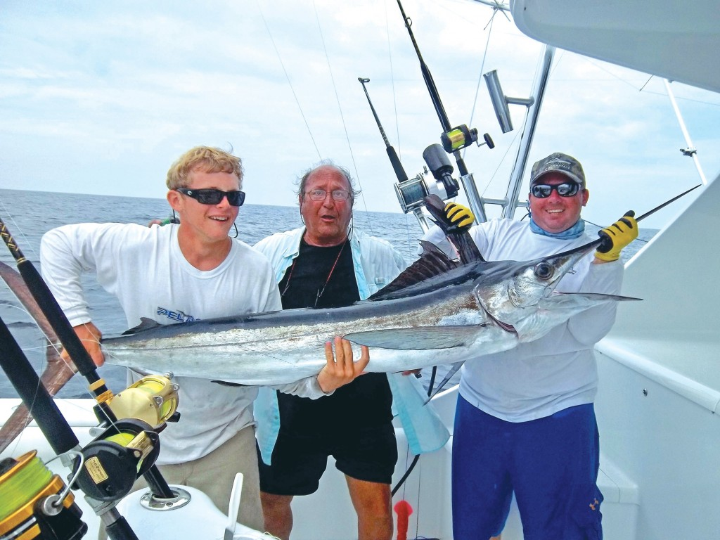 captain paul ivey with a billfish offshore