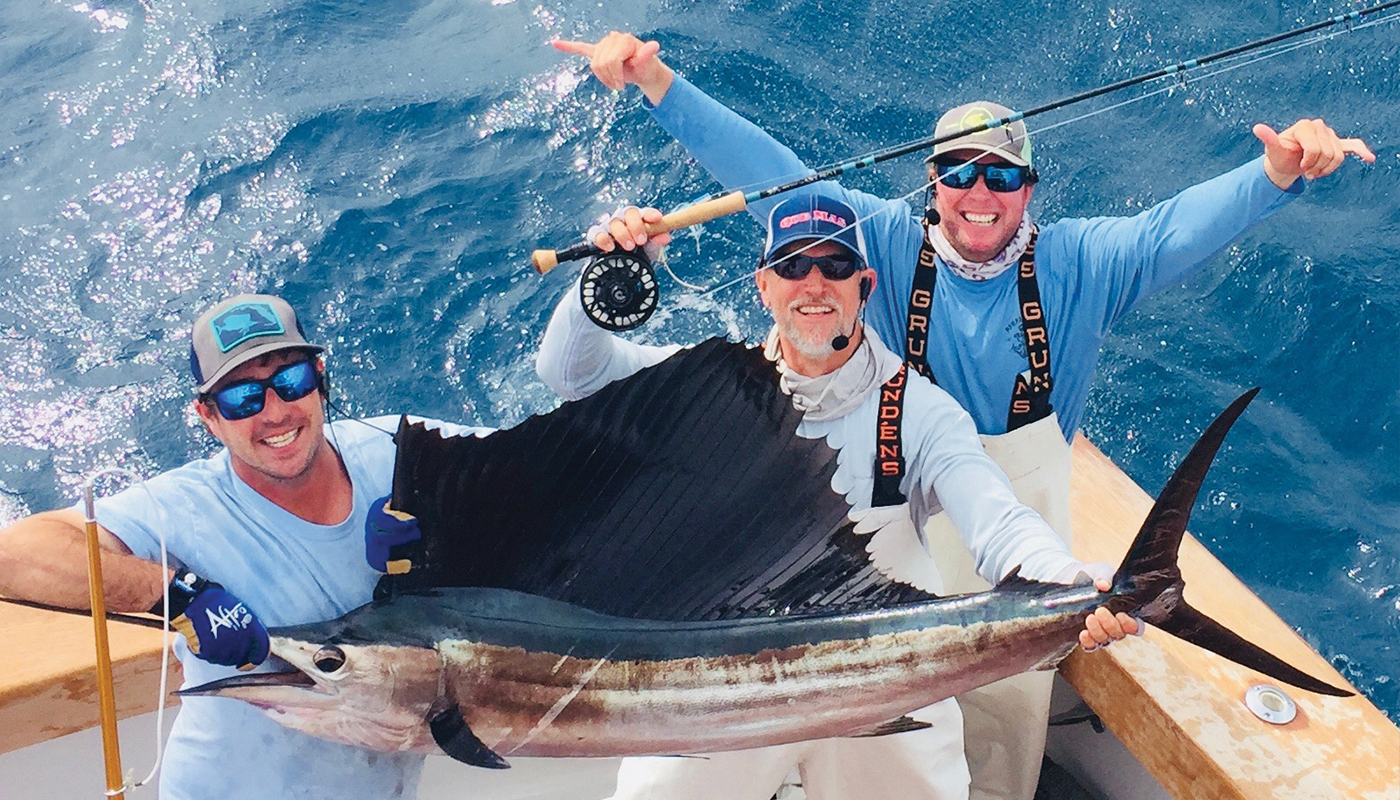 holding a sailfish for picture