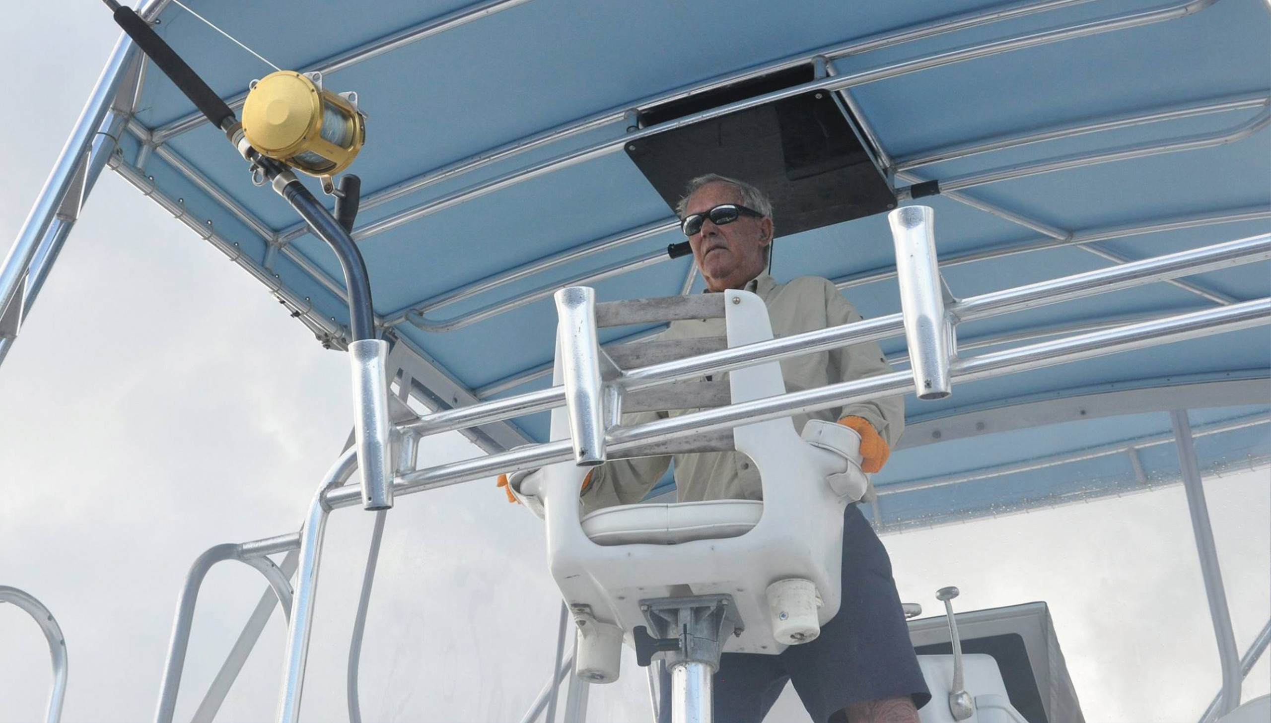 Captain Alan Card at the helm of the Challenger