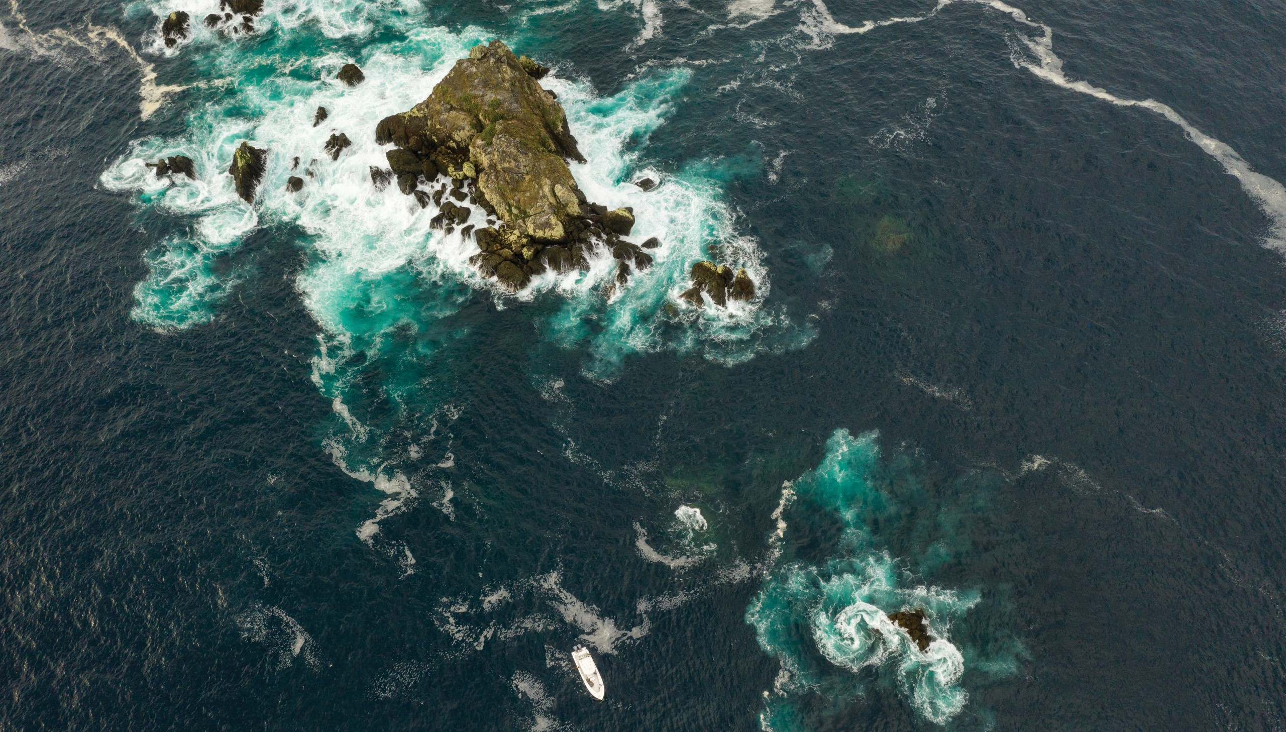 Aerial view of rocks and ocean