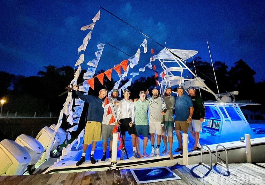 Vice Versa boat crew with 76 release flags