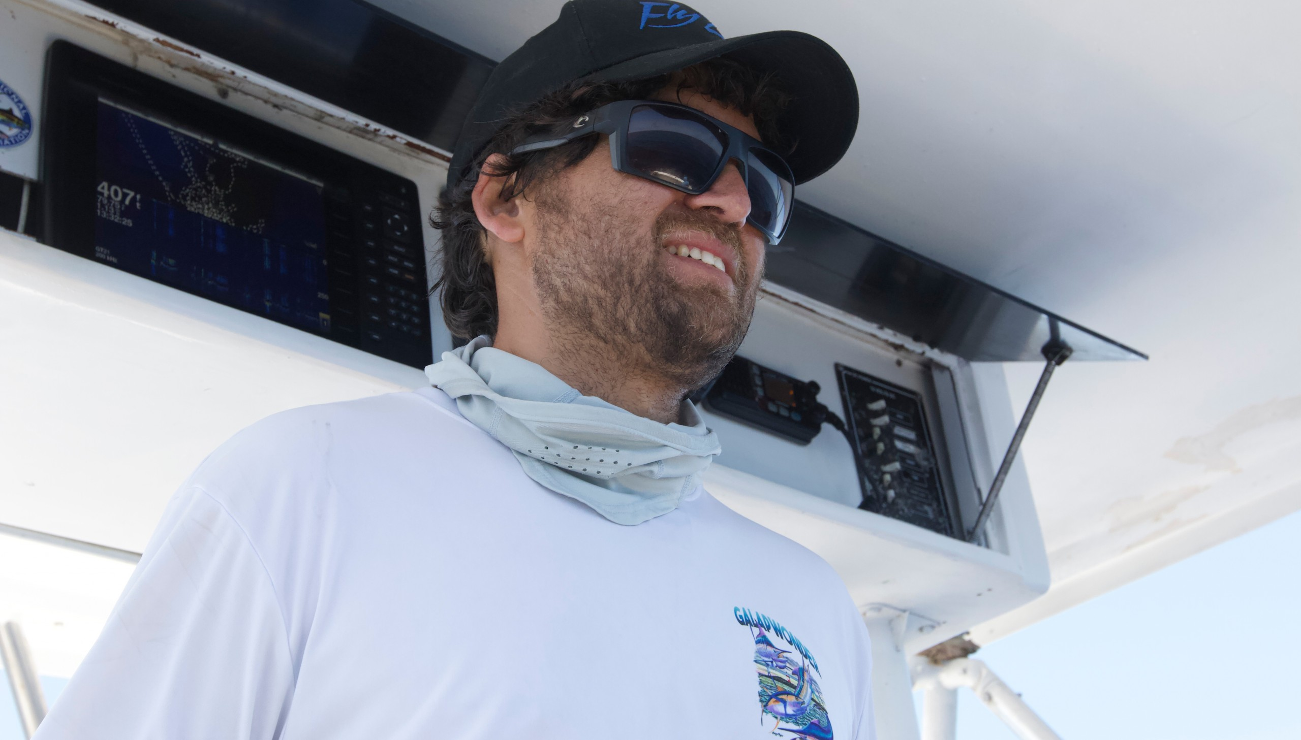picture of Juan Kayser at the helm of the boat