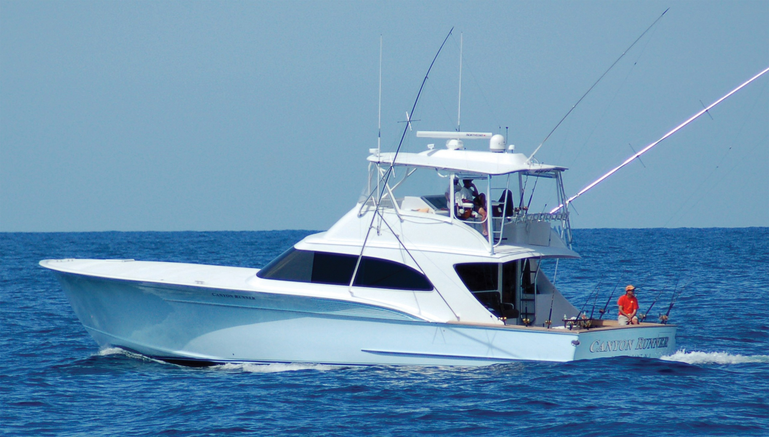 Canyon Runner sportfish boat trolling on blue ocean
