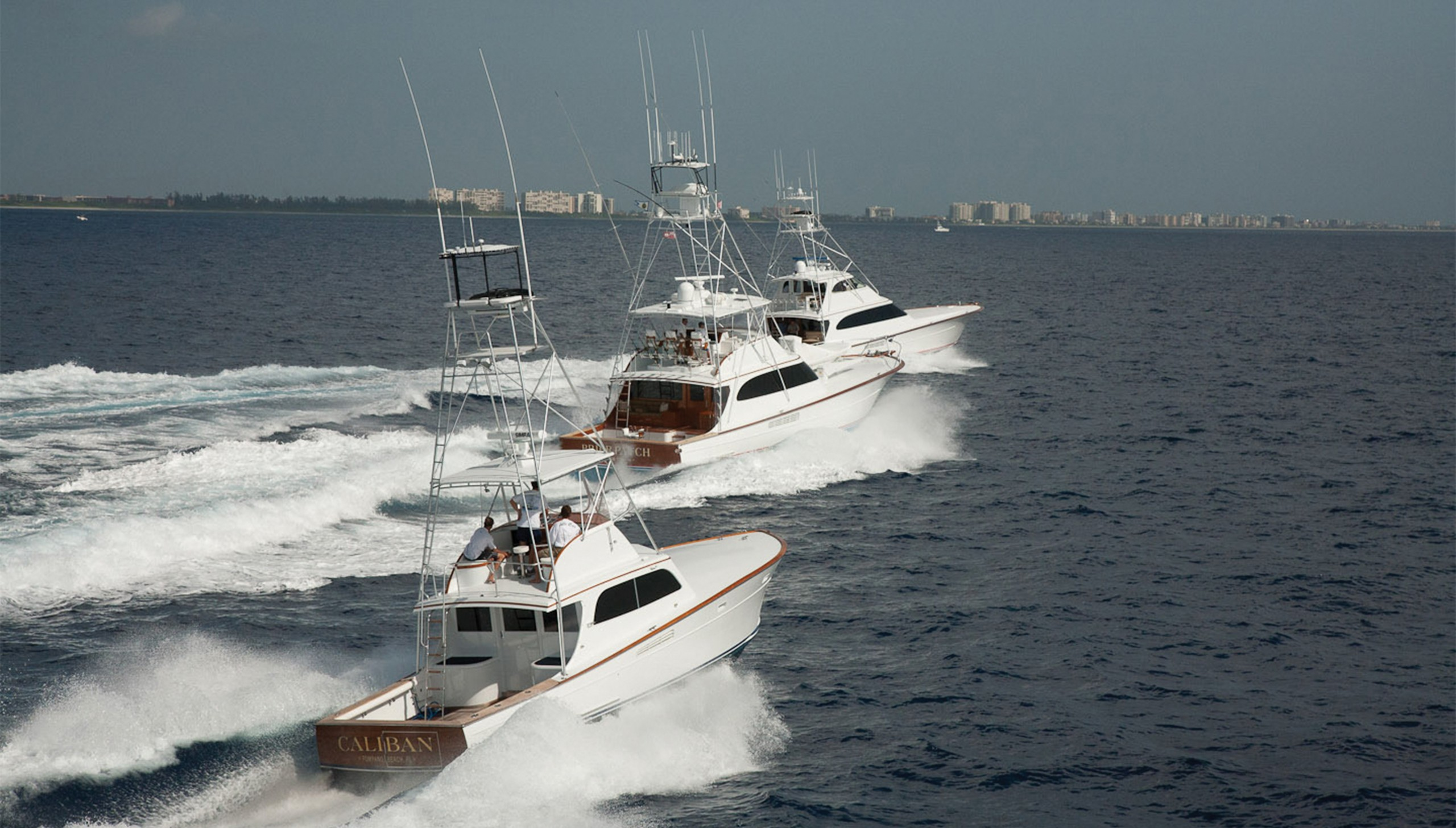 3 Merritt boats running in formation off the coast of Florida