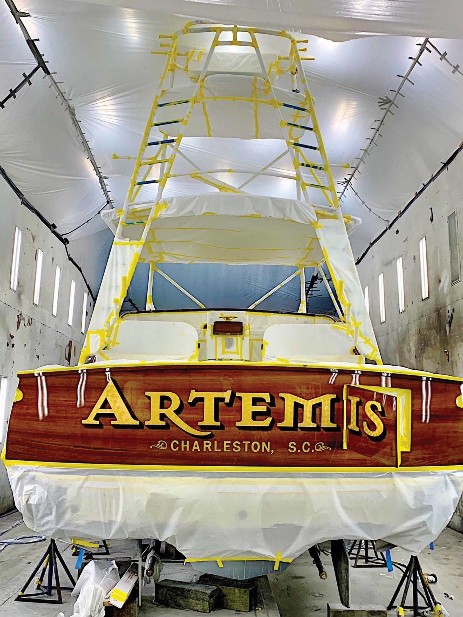 artemis boat in paint shed