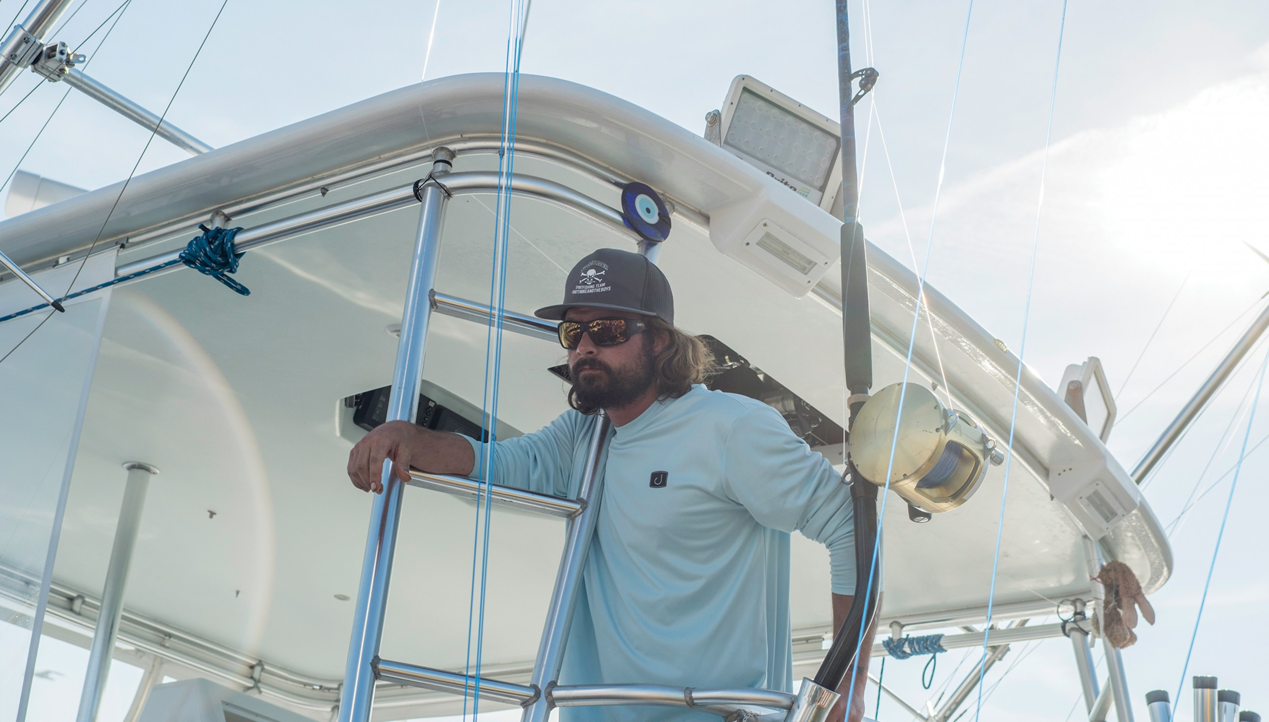captain Kyle Peet standing on his boat