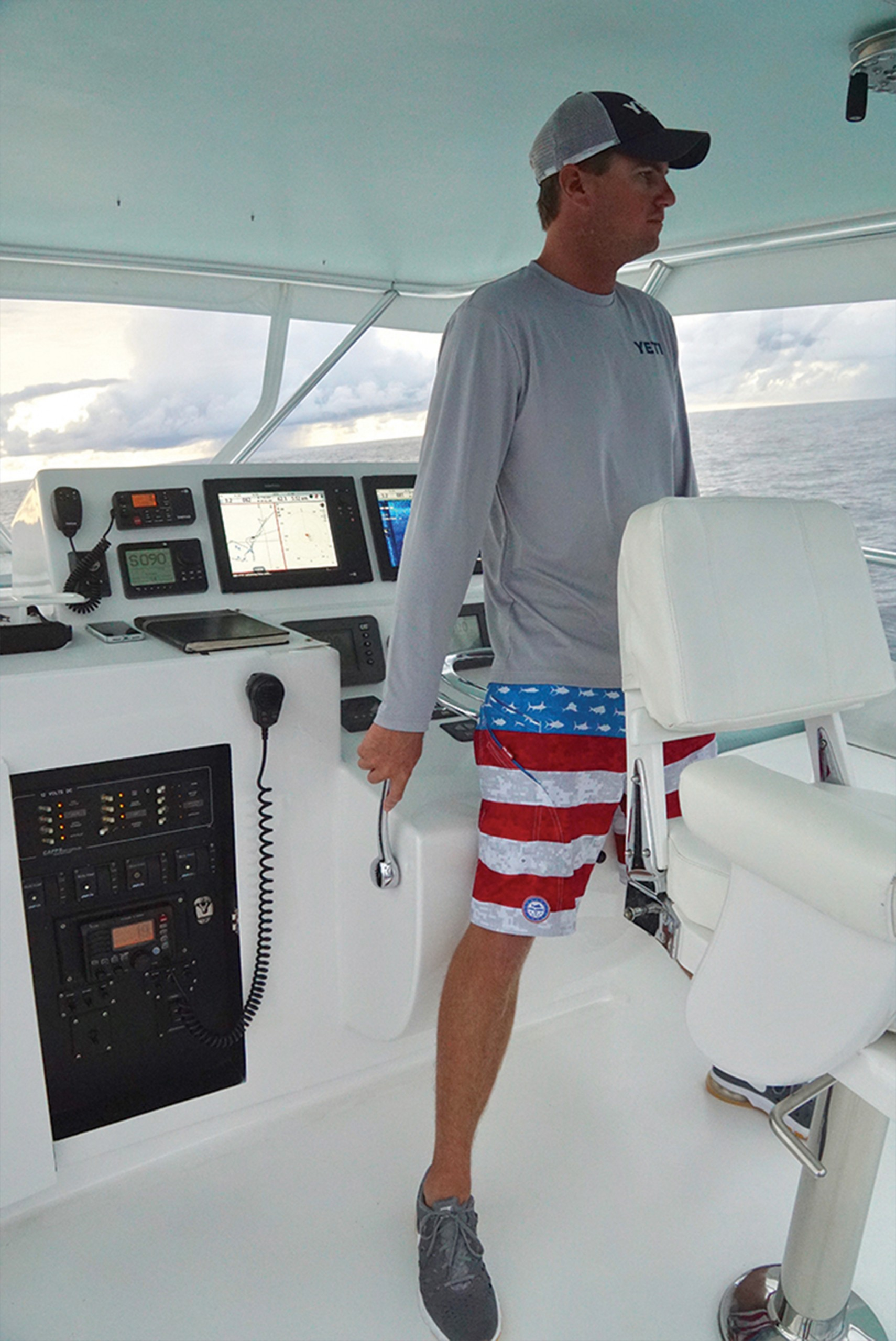 Captain Drake Sawyer at the helm
