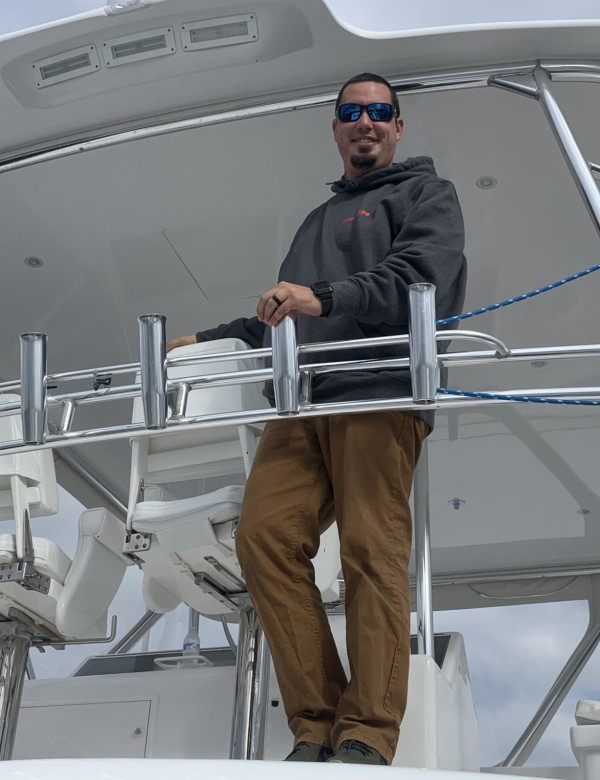captain ryan knapp standing on his boat