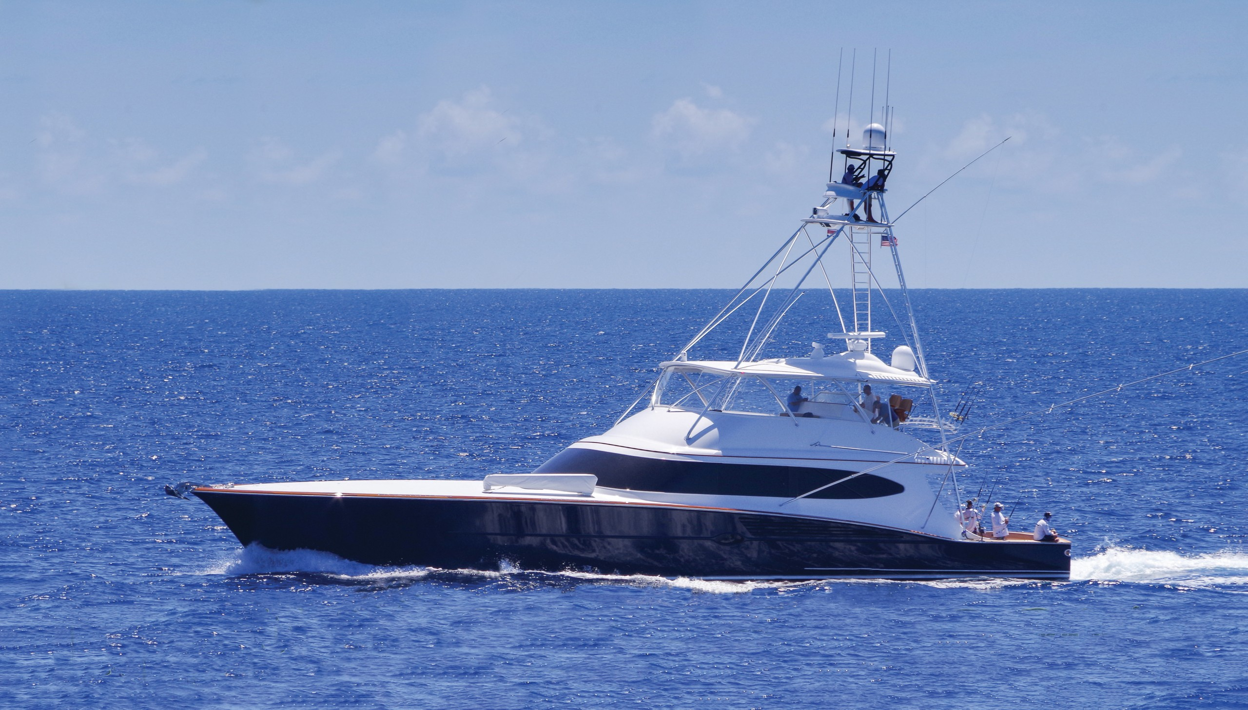 blue sportfishing boat on blue ocean
