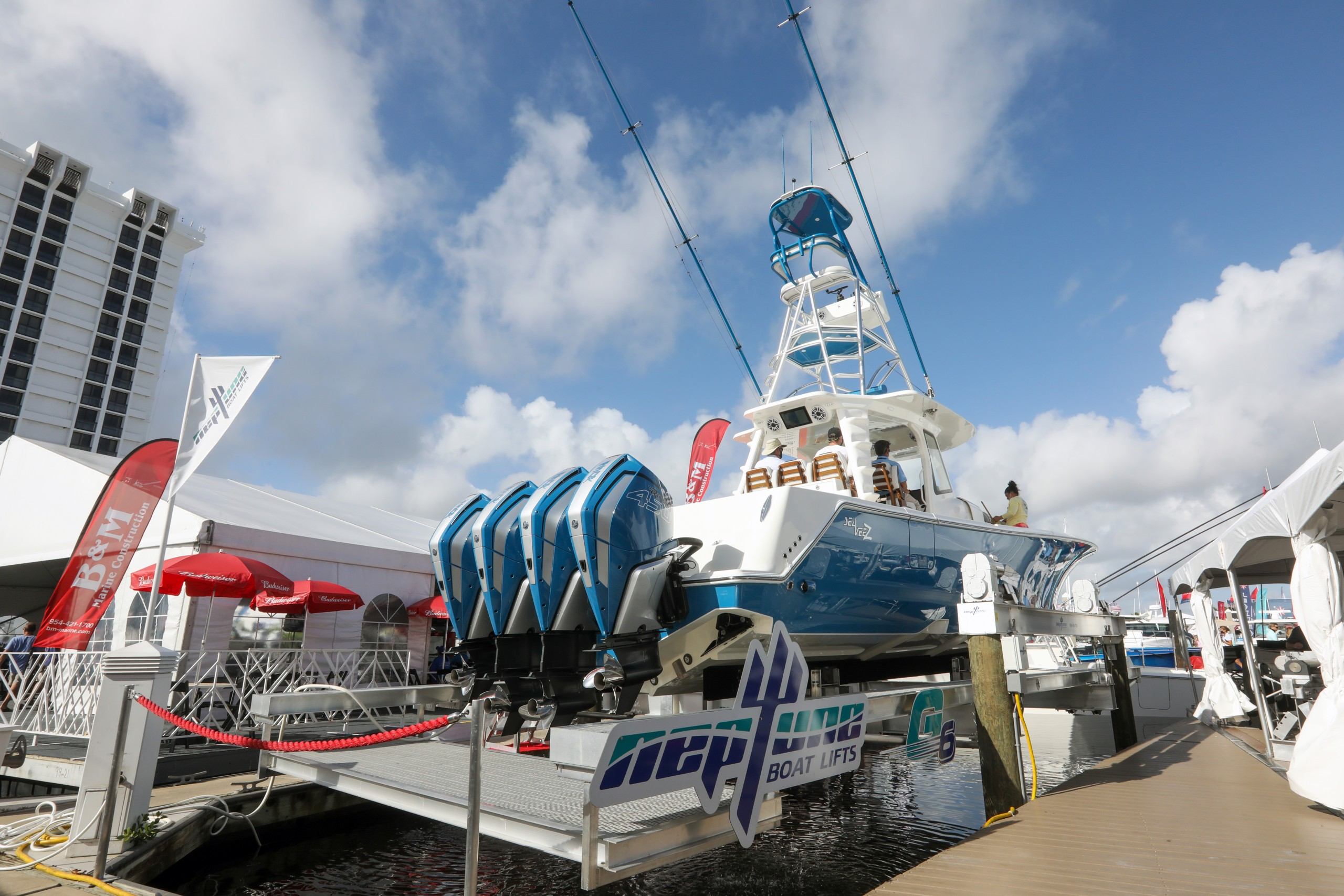 neptune boat lifts on display at the fort lauderdale boat show