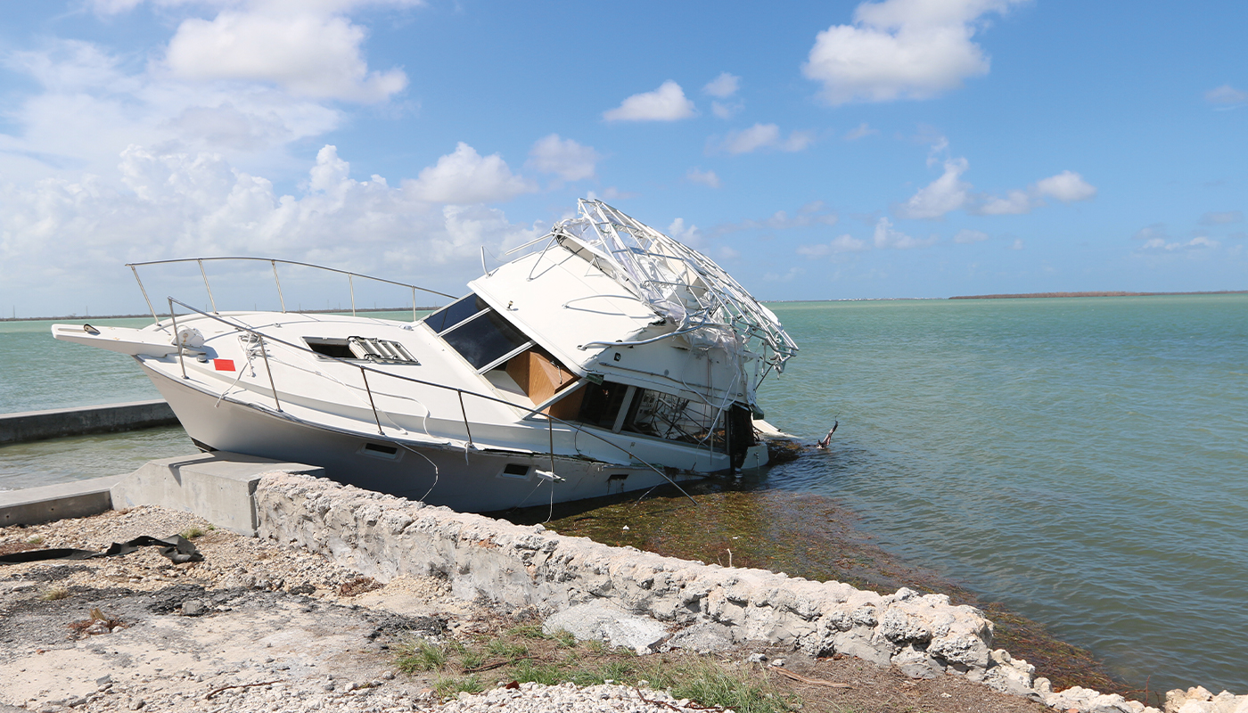 boat run aground on beach used for boat salvage
