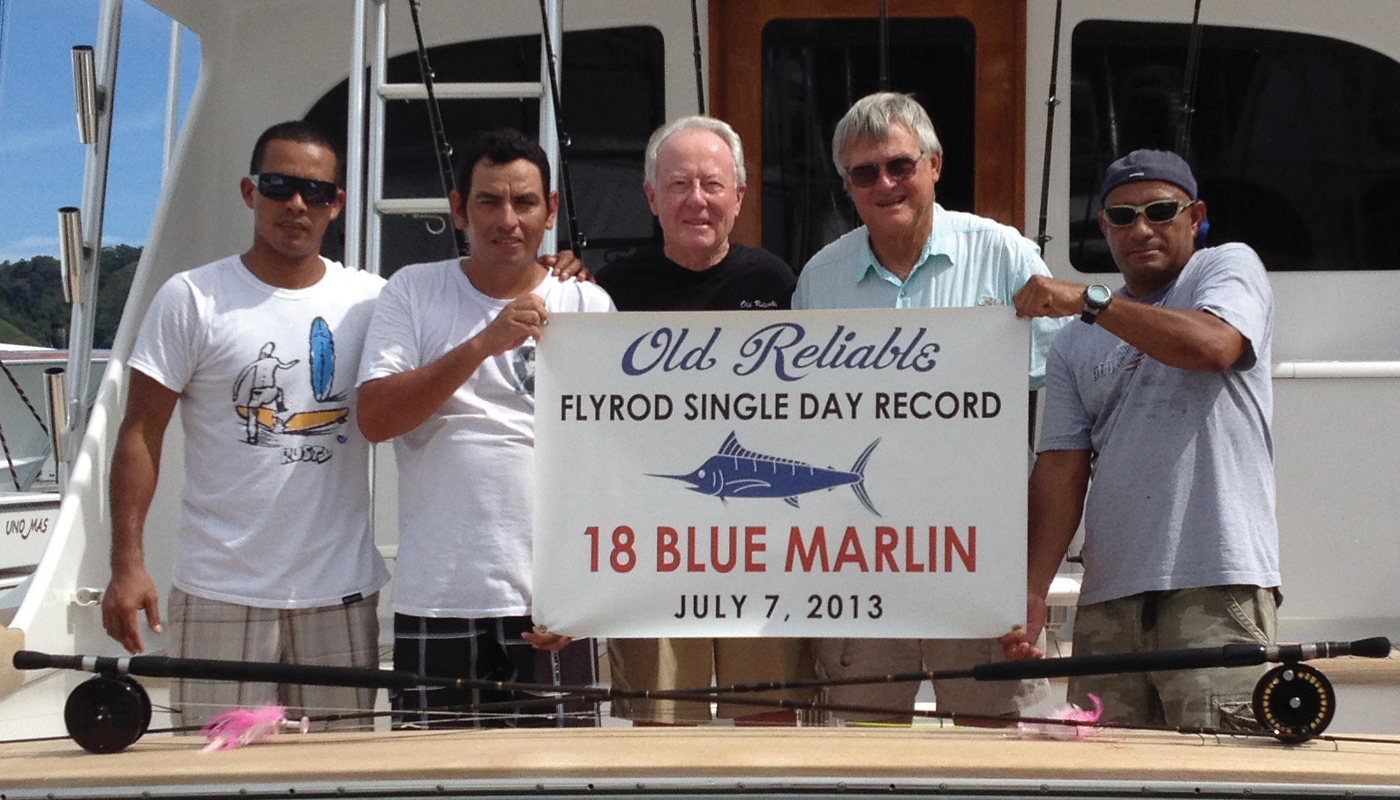 Nick Smith holding a flyrod single day record banner