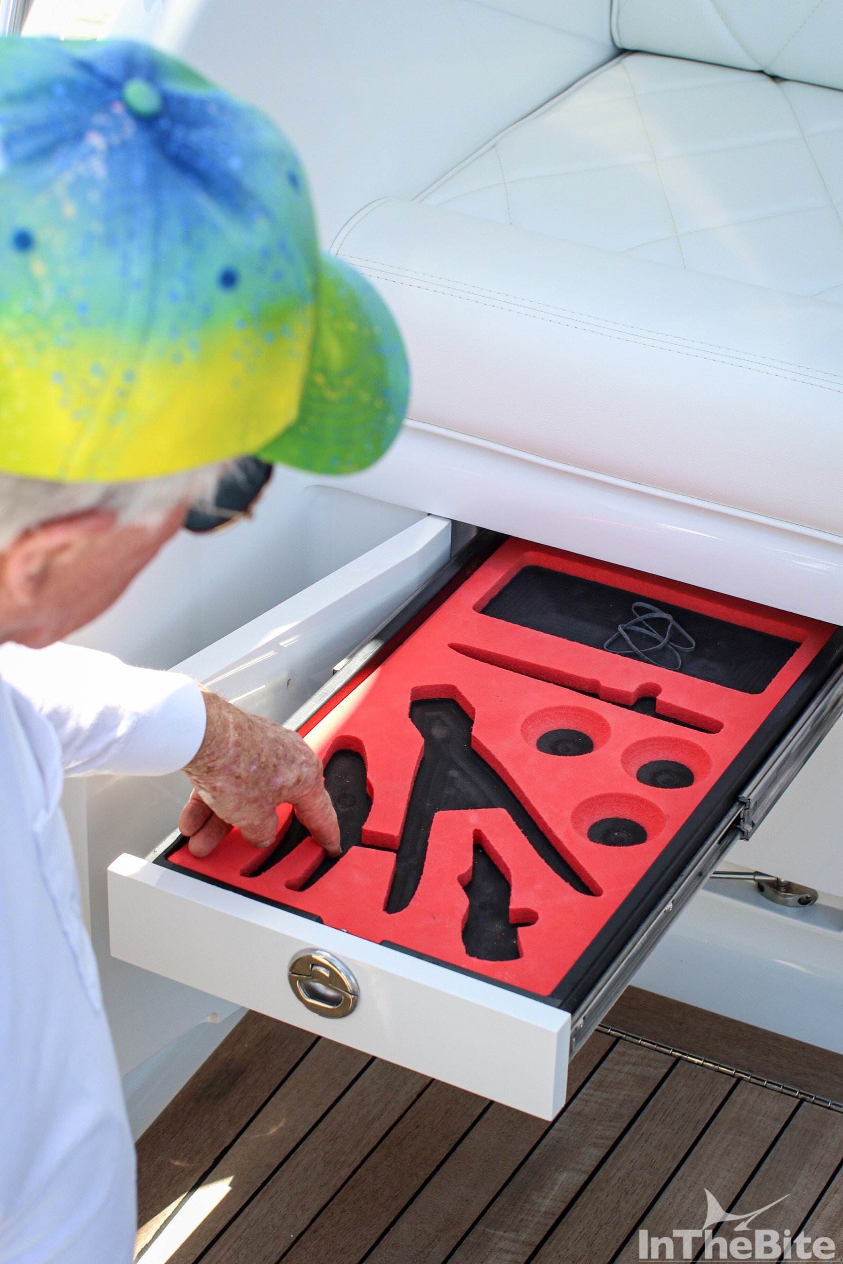 Nick Smith pointing to a tool drawer on his 72 bayliss old reliable