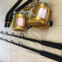 Two Penn International II 130ST reels on custom rods. Excellent condition